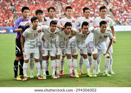 Kallang,Singapore - JUNE 13:Players of Vietnam U23 shot photo during the 28th SEA Games Singapore 2015 match between Vietnam and Myanmar at Singapore National Stadium on JUNE13 2015 - stock photo