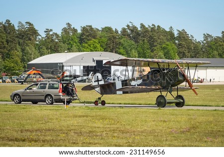 KALLINGE, SWEDEN - JUNE 01, 2014: Swedish Air Force air show 2014 at F 17 Wing.  Fokker D.VII carrying by the car.