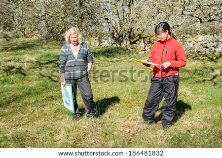 KALMAR, SWEDEN - APRIL 05, 2014: Two female nature guides educating on guide tour.
