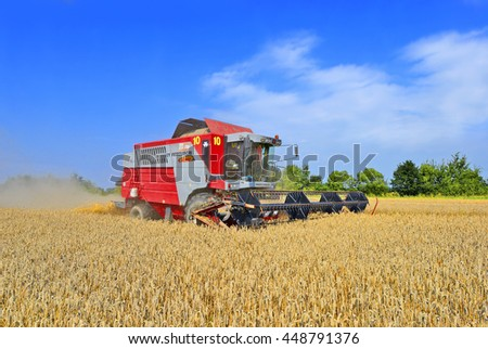 Kalush, Ukraine - August 2: Modern  combine harvesting grain in the field near the town Kalush, Western Ukraine August 2, 2014