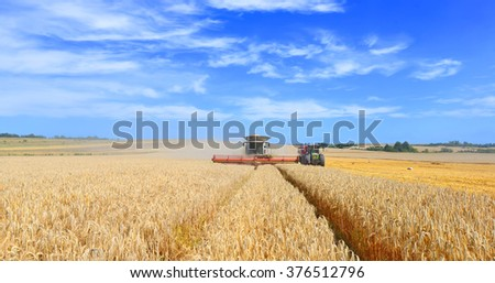 Kalush, Ukraine - August 4: Overloading grain harvester in tractor trailer tank in the field near the town Kalush, Western Ukraine August 4, 2015