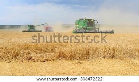 Kalush, Ukraine - July 17: Modern John Deere combine harvesting grain in the field near the town Kalush, Western Ukraine July 17, 2015 - stock photo