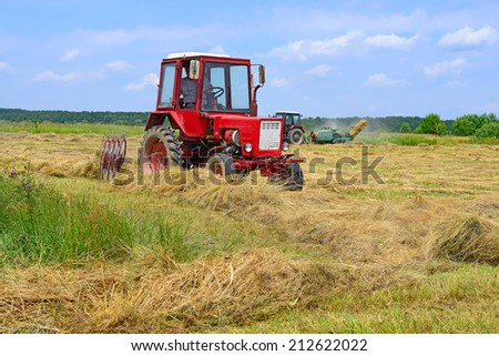 Kalush, Ukraine - June 25: Hay harvesting in the field near the town Kalush, Western Ukraine June 25, 2014