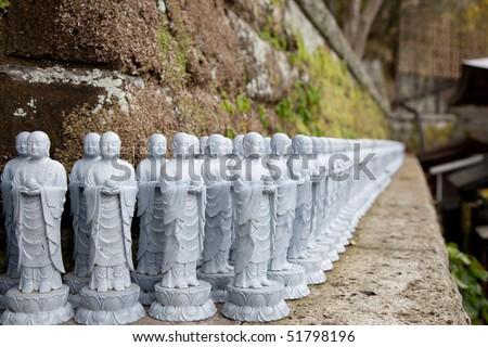 Kamakura, Japan - Statues decorating the Hasedera temple - stock photo