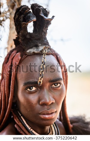KAMANJAB, NAMIBIA - JAN 8, 2016: Unidentified woman from Himba tribe. The Himba are indigenous people living in northern Namibia and Angola