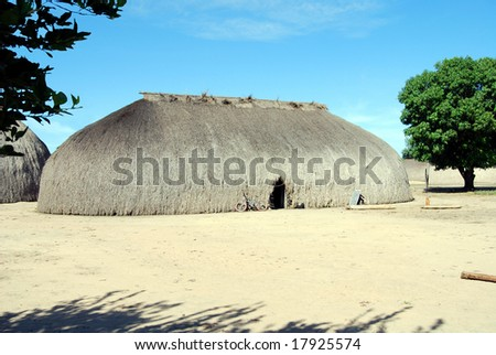 KAMAYURA VILLAGE, BRAZIL - MAY 18: The entire Kamayura tribe lives in one single village near Xingu river, in large houses covered with sape grass. Shot on May 18, 2008. - stock photo