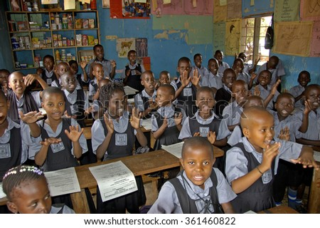 Kampala, Uganda-10 April 2017 Unidentified children in township school near Kampala. Most children can walk to school and are save at school were the also get food thanks to foreign charity. - stock photo