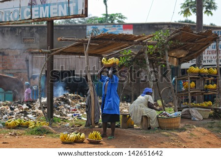 KAMPALA, UGANDA - AUG 26: Native people sell banana at local market on Aug 26, 2010 in slum of Kampala. Nearly 40% of slum dwellers have a monthly income of just 2,500 shillings �¢?? less than a dollar - stock photo