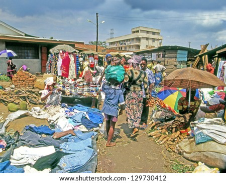 KAMPALA, UGANDA - JULY 24: An unidentified people buy at the market on July 24, 2004 in Kampala, Uganda. Uganda is one of the poorest nations in the world. - stock photo