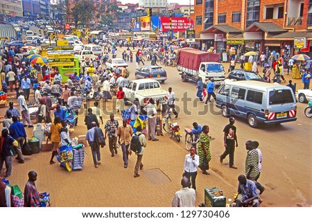 KAMPALA, UGANDA - JULY 24: An unidentified people on the street on July 24, 2004 in Kampala, Uganda. Uganda is one of the poorest nations in the world. - stock photo