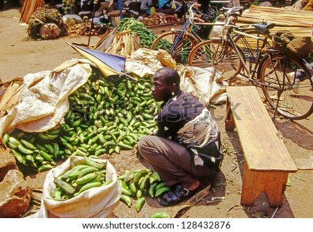 KAMPALA, UGANDA - JULY 24:  unidentified people buy at the market on July 24, 2004 in Kampala. Uganda is one of the poorest nations in the world. - stock photo