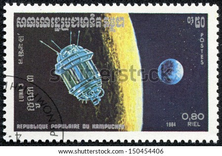KAMPUCHEA - CIRCA 1984: a stamp from Kampuchea shows image of Soviet space probe Luna 3, circa 1984 - stock photo