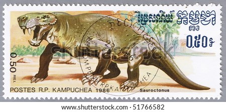 KAMPUCHEA - CIRCA 1986: A stamp printed in Kampuchea shows Sauroctonus, series devoted to prehistoric animals, circa 1986 - stock photo
