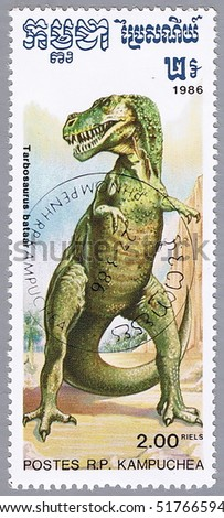 KAMPUCHEA - CIRCA 1986: A stamp printed in Kampuchea shows Tarbosaurus, series devoted to prehistoric animals, circa 1986 - stock photo