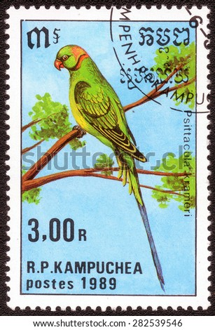 "KAMPUCHEA - CIRCA 1989: A stamp printed in Kampucheashows a shows a series of images ""species of parrots"", circa 1989"