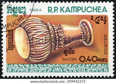 KAMPUCHEA-CIRCA 1984: A stamp printed in the Cambodia, shows a traditional musical instrument Skor, circa 1984 - stock photo