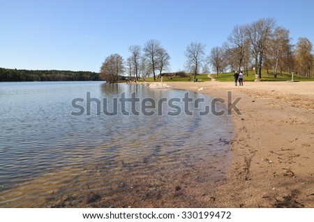 KANAAN, STOCKHOLM, SWEDEN - APRIL 22, 2011: People enjoy first day of spring by empty beach on April 22, 2011 in Stockholm, Sweden.