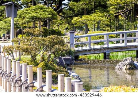 Kanazawa, Japan - April 24, 2014: View of Kenroku-en (Six Attributes Garden), an old private garden. Along with Kairaku-en and Koraku-en, Kenroku-en is one of the Three Great Gardens of Japan. - stock photo