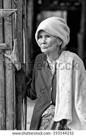 KANCHANABURI THAILAND-January 29: An unidentified old Mon ethnic woman poses for the photo at her house on January 29, 2012  at KANCHANABURI THAILAND. Mon are an ethnic group spread in Thailand.