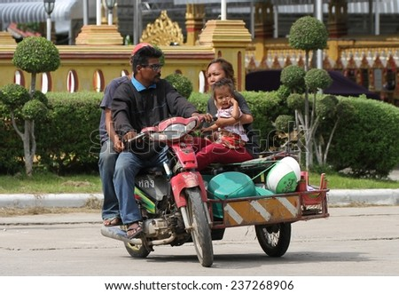 KANCHANABURI, THAILAND - SEPTEMBER 4: A family on a motorbike in the town of Kanchanaburi, Thailand on the 4th September, 2014.