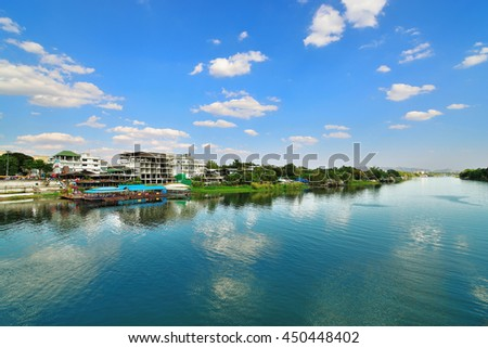 KANCHANABURI, THAILAND ,Village and restaurants lining the river banks in the blue sky in the countryside . - stock photo