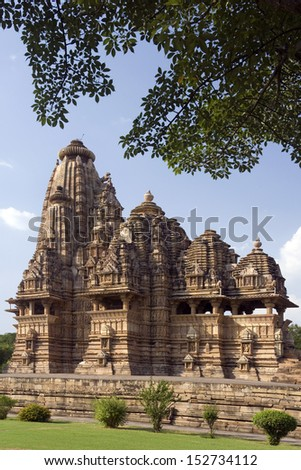 Kandariya Mahadev Hindu Temple at Khajuraho in the Madhya Pradesh region of India. The complex of temples at Khajuraho are famous for their erotic sculptures and are a UNESCO World Heritage site.