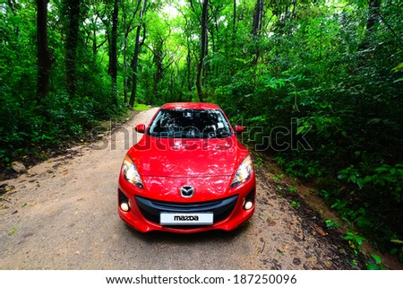 KANDY, SRI LANKA � OCTOBER 21, 2013: Photo of 2013 Mazda 3 in Kandy , Sri Lanka. Mazda 3 is a compact car manufactured in Japan by the Mazda Motor Corporation. Known as the Mazda Axela in Japan.  - stock photo