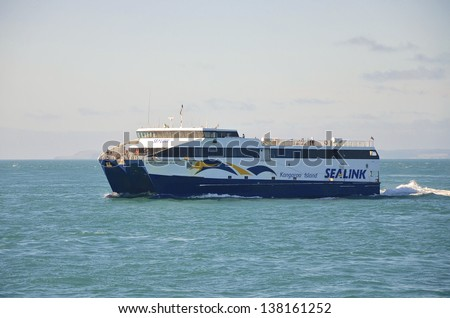 KANGAROO ISLAND, AUSTRALIA - FRIDAY 19 OCTOBER 2012: The Sealink Ferry crossing over the ocean from the South Australian coast to Penneshaw on Friday 19 October 2012 at Kangaroo Island. - stock photo
