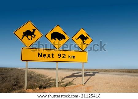 Kangaroo, wombat and camel warning sign Australia - stock photo