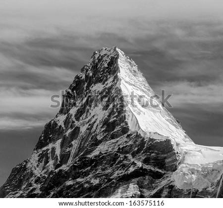 Kangchung (6062 m) peak in the area of Cho Oyu - Gokyo region, Nepal (black and white) - stock photo