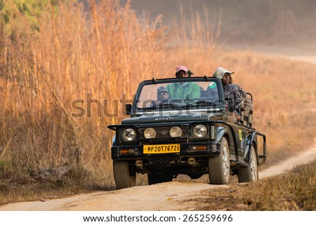 KANHA, INDIA - FEBRUARY 04:  A vehicle with visitors on safari in Kanha National Park on February, 04 in village of Kanha. - stock photo