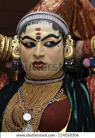 KANNUR - DECEMBER 06: Unidentified Kathakali performer applying face make-up prior to a performance on December 06, 2011 at a small village near Kannur, Kerala, India.
