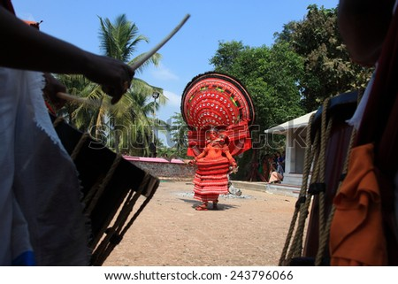 KANNUR - JAN 05: A Theyyam artist performs during the annual festival at Kadannappalli Muchilot Bhagavati temple on January 05, 2015 in Kannur, India.Theyyam is a ritualistic folk art form of Kerala - stock photo