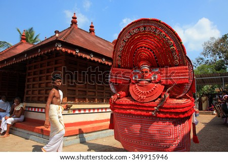 KANNUR - JAN 05: An unidentified Theyyam artist performs at Kadannappalli Muchilot Bhagavati temple on January 05, 2015 in Kannur, India.Theyyam is a ritualistic traditional art form of Kerala - stock photo