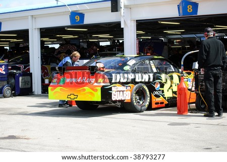 KANSAS CITY, KS - OCT 2:  Nascar Driver Jeff Gordon's car is being worked on in the garage on qualifying day on October 2, 2009 in Kansas City, KS. - stock photo