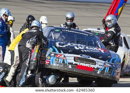 KANSAS CITY, KS - OCT 02:  Trevor Bayne brings in his Con-way Freight Ford Fusion in for service on October 2, 2010 during the Kansas Lottery 300 race at the Kansas Speedway in Kansas City, KS. - stock photo