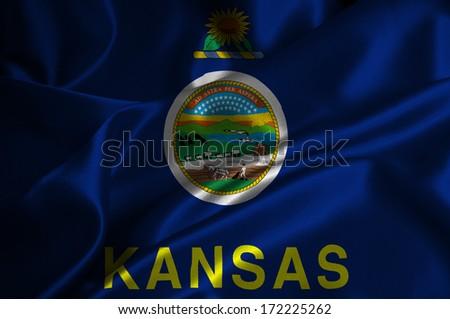 Kansas flag on satin texture. - stock photo