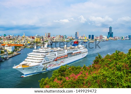 KAOHSIUNG -TAIWAN, AUGUST 9 2013: famous cruise Star Cruises, SuperStar Gemini's in Kaohsiung, Taiwan on August 9 2013, Star Cruises is the world's third largest cruise company. - stock photo