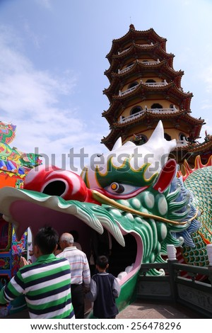 Kaohsiung - Taiwan, February 22, 2015: Local and Chinese-style architectural features - Dragon and Tiger Pagodas, the influx of so many visitors come to play every day. - stock photo