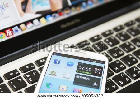 KAOHSIUNG, TAIWAN - FEBRUARY 06, 2014: Social media are trending and both business as consumer are using it for information sharing and networking. - stock photo