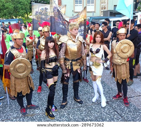 KAOHSIUNG, TAIWAN -- JUNE 17, 2015: Actors dressed up in fantasy costumes promote the mobile app strategy game Clash of Kings at a public event. - stock photo