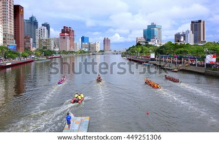 KAOHSIUNG, TAIWAN -- JUNE 9, 2016: Four unidentified teams compete in boat races on the Love River during Dragon Boat Festival.