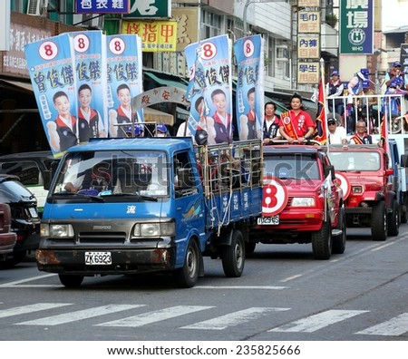 KAOHSIUNG, TAIWAN -- NOVEMBER 27, 2014: City council candidate Zeng Jun Jie parades through the streets in the run up to the local elections. - stock photo