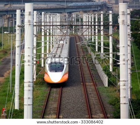KAOHSIUNG, TAIWAN -- OCTOBER 17, 2015: A modern bullet train of the Taiwan High Speed Railway Corporation sits on its tracks.  - stock photo
