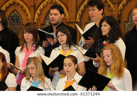 KAPOSVAR, HUNGARY - AUGUST 26: Members of the Liszt Ferenc Music School Choir sing at the IV. Pannonia Cantat Youth Choir Festival August 26, 2010 in Kaposvar, Hungary