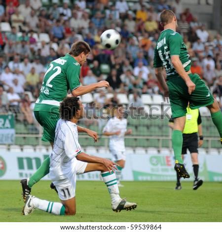 KAPOSVAR, HUNGARY - AUGUST 14: Richard Guzmics (22) heads the ball at a Hungarian National Championship soccer game Kaposvar vs. Haladas August 14, 2010 in Kaposvar, Hungary. - stock photo