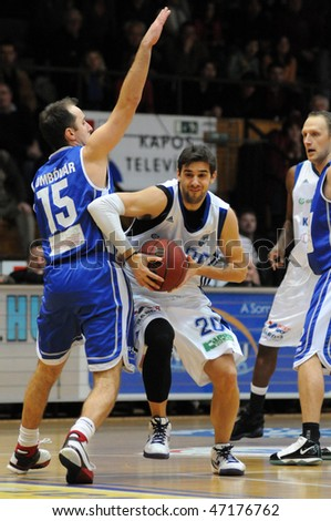 KAPOSVAR, HUNGARY - FEBRUARY 20: Matija Ceskovic (C) in action at Hugarian Champonship basketball game Kaposvar vs Dombovar February 20, 2010 in Kaposvar, Hungary.