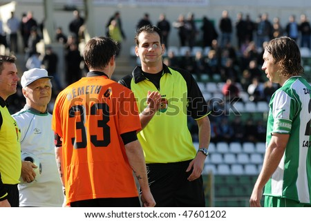 KAPOSVAR, HUNGARY - FEBRUARY 27: The referee adds lustre to the money before a Hungarian National Championship soccer game Kaposvar vs Budapest Honved February 27, 2010 in Kaposvar, Hungary.