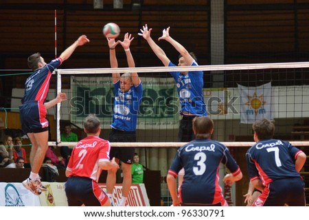 KAPOSVAR, HUNGARY - FEBRUARY 23: Unidentified players in action at a Hungarian volleyball National Championship game Kaposvar (blue) vs. Csepel (deep blue), on February 23, 2012 in Kaposvar, Hungary. - stock photo