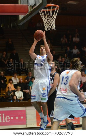 KAPOSVAR, HUNGARY - JANUARY 30: Daniel Werner (15) in action at a Hungarian National Championship basketball game Kaposvar vs Pecs January 30, 2011 in Kaposvar.